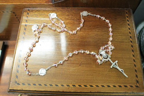 Vintage pink rosary beads.