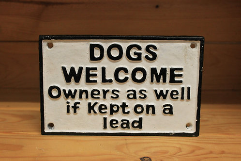 Dogs welcome cast iron sign.