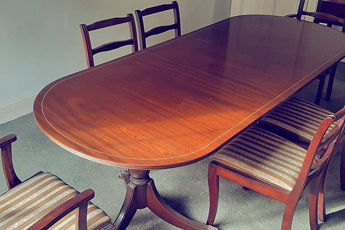 Mahogany dining room table with tripod legs , centre leaf and 6 chairs.