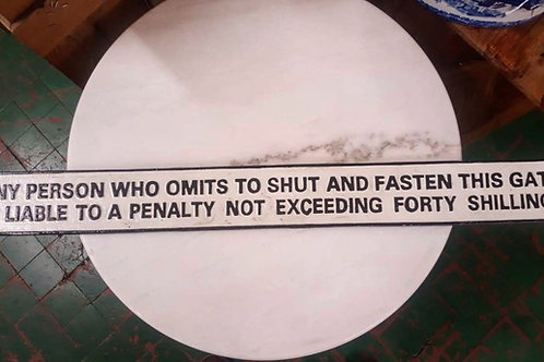 Any person who omits.... (Long Cast Iron sign)