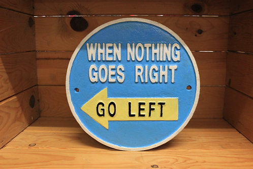 When nothing goes right go left cast iron sign.