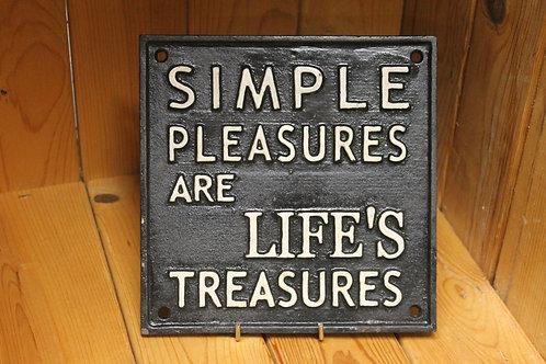 Simple pleasures cast iron sign.