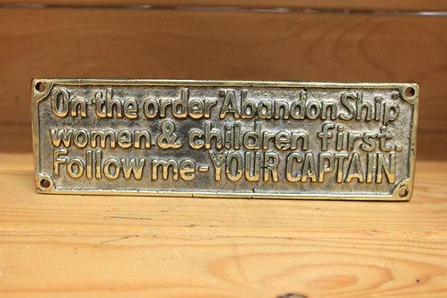 Abandon ship brass sign.