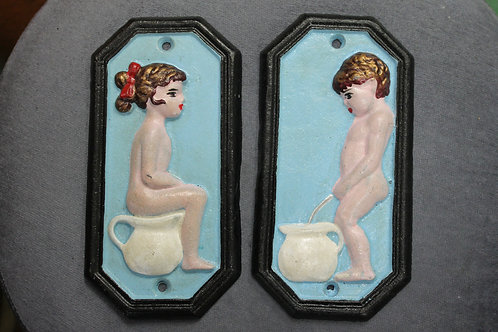 Boy and girl toilet signs