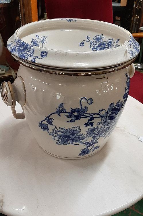 Ceramic slop bucket.