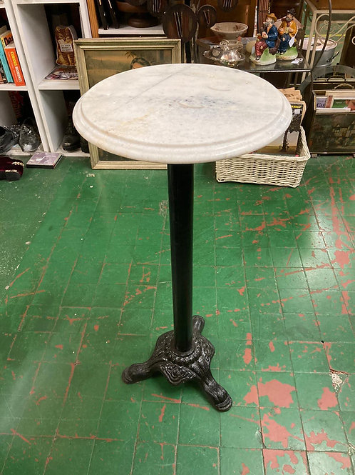 Cast Iron table with marble top.