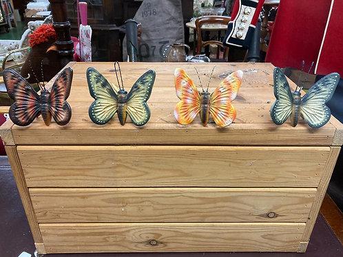 4 cast iron garden butterflies.