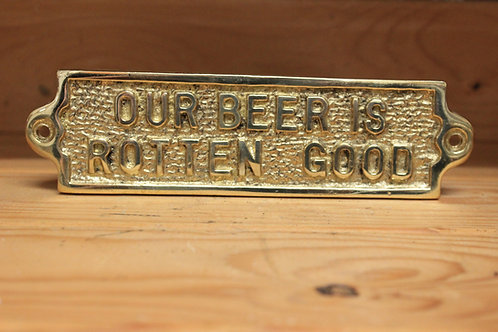 Our beer is rotten good brass sign.