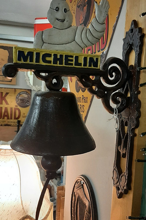 Michelin man cast iron bell.
