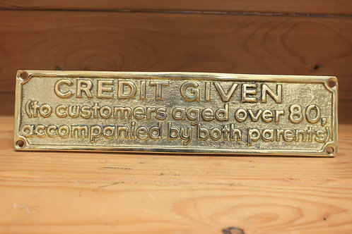 Credit given brass sign.