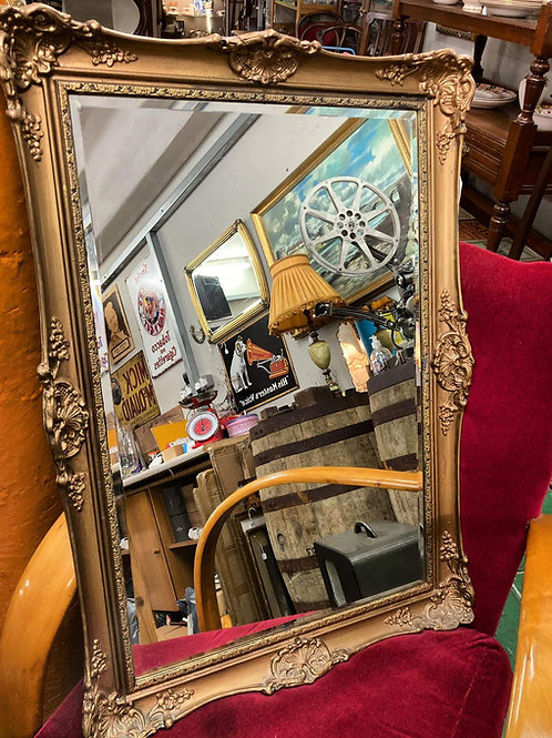 Gold coloured mirror.
