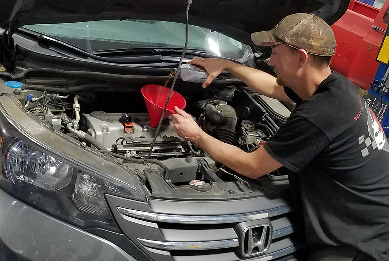 Shawn Cook performing oil change