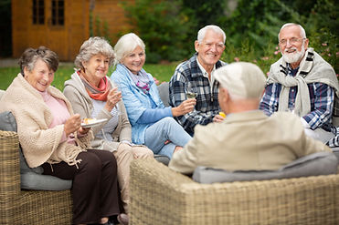 group-of-senior-friends-sitting-together-in-the-ga-LPD54JV-min.jpg