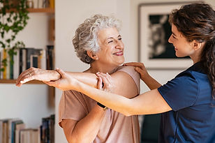 senior-woman-with-trainer-exercising-at-home-2UCM4L9-min.jpg