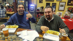 Our Chile Verde fries had the man on the left covered in sweat !! It was so spicy yet had so much fl