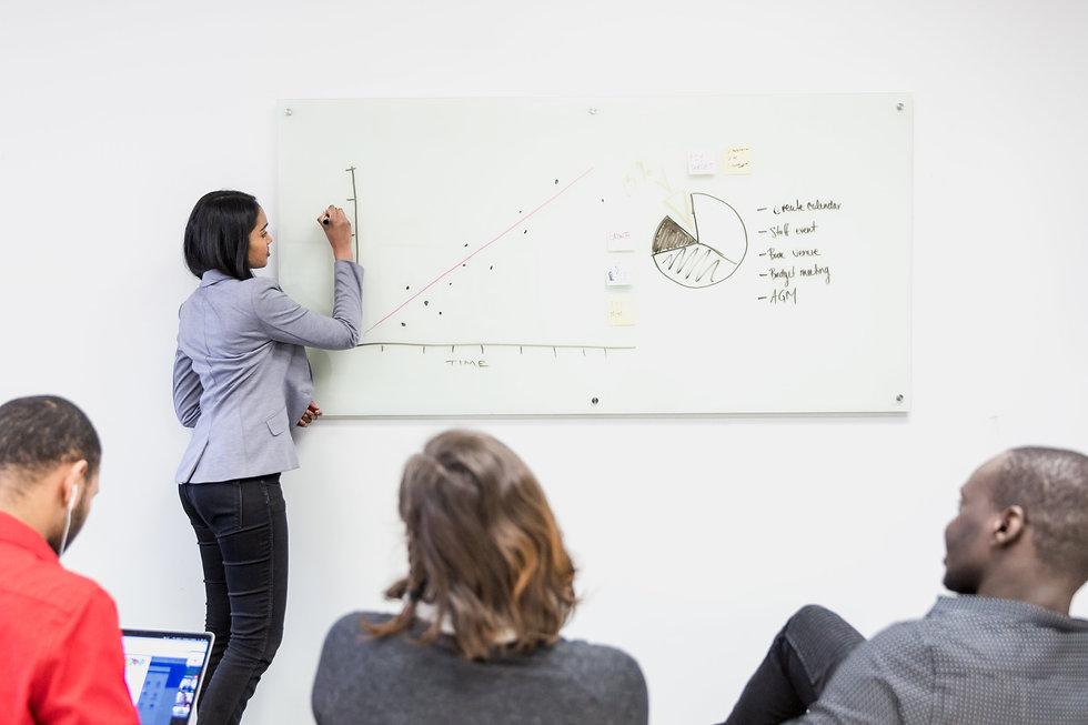 girl-presents-on-whiteboard.jpg