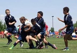 u12 Tackle team in action