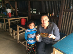Enjoying a meal cooked by  my little friend's father