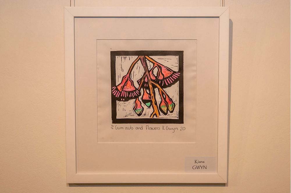 Kiana Gwyn's hand-coloured lino-print, 'Gum Nut and Flowers'.