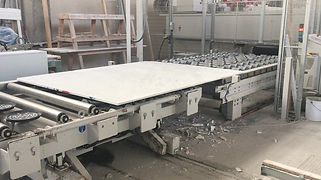 Carrara-white-marble-slabs entering automatic cutting line
