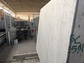 Carrara-white-marble-slabs in the  cart ready to enter the cut