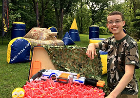 Austin Dasher, 17, brings inflatable barriers, Nerf guns and darts to birthday parties and community events with his company, Nerf Wars.