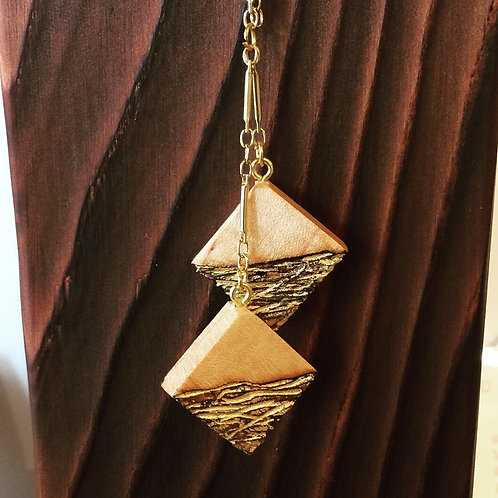 Char maple and gold pendant