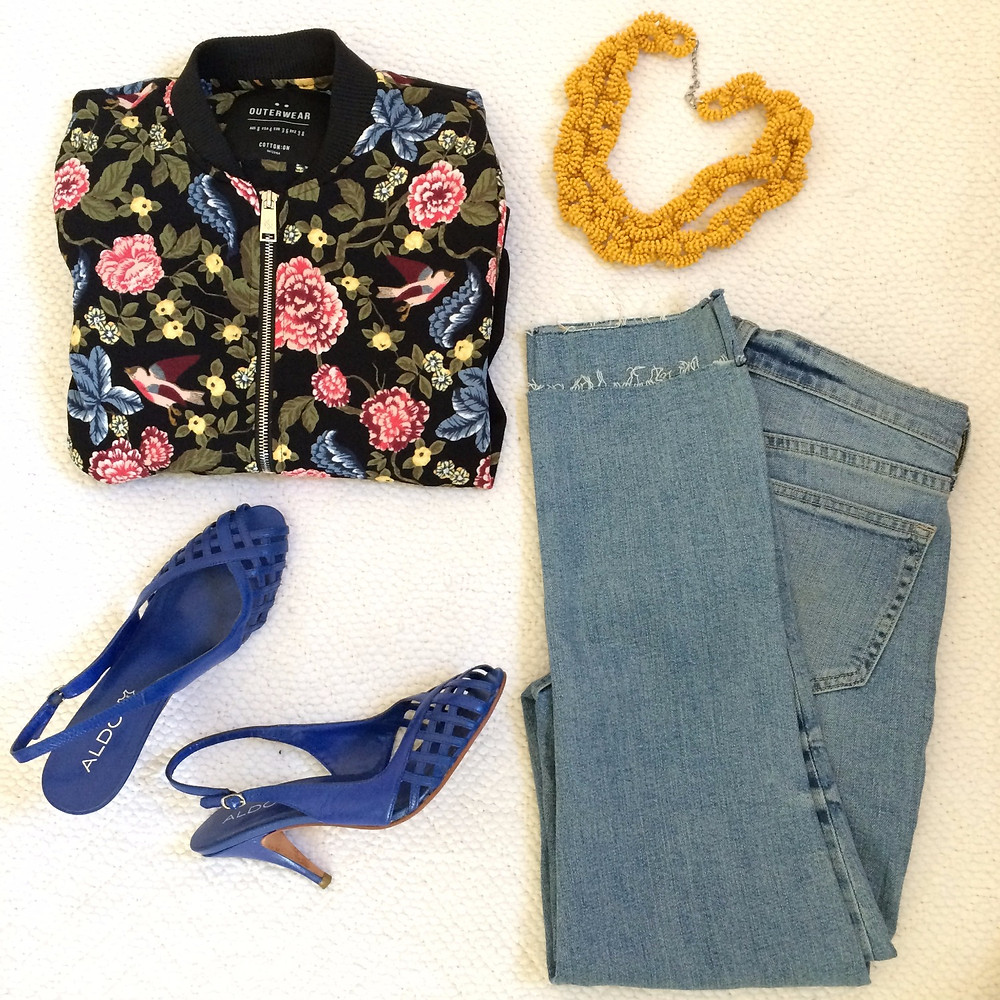 flat lay outfit with yellow necklace