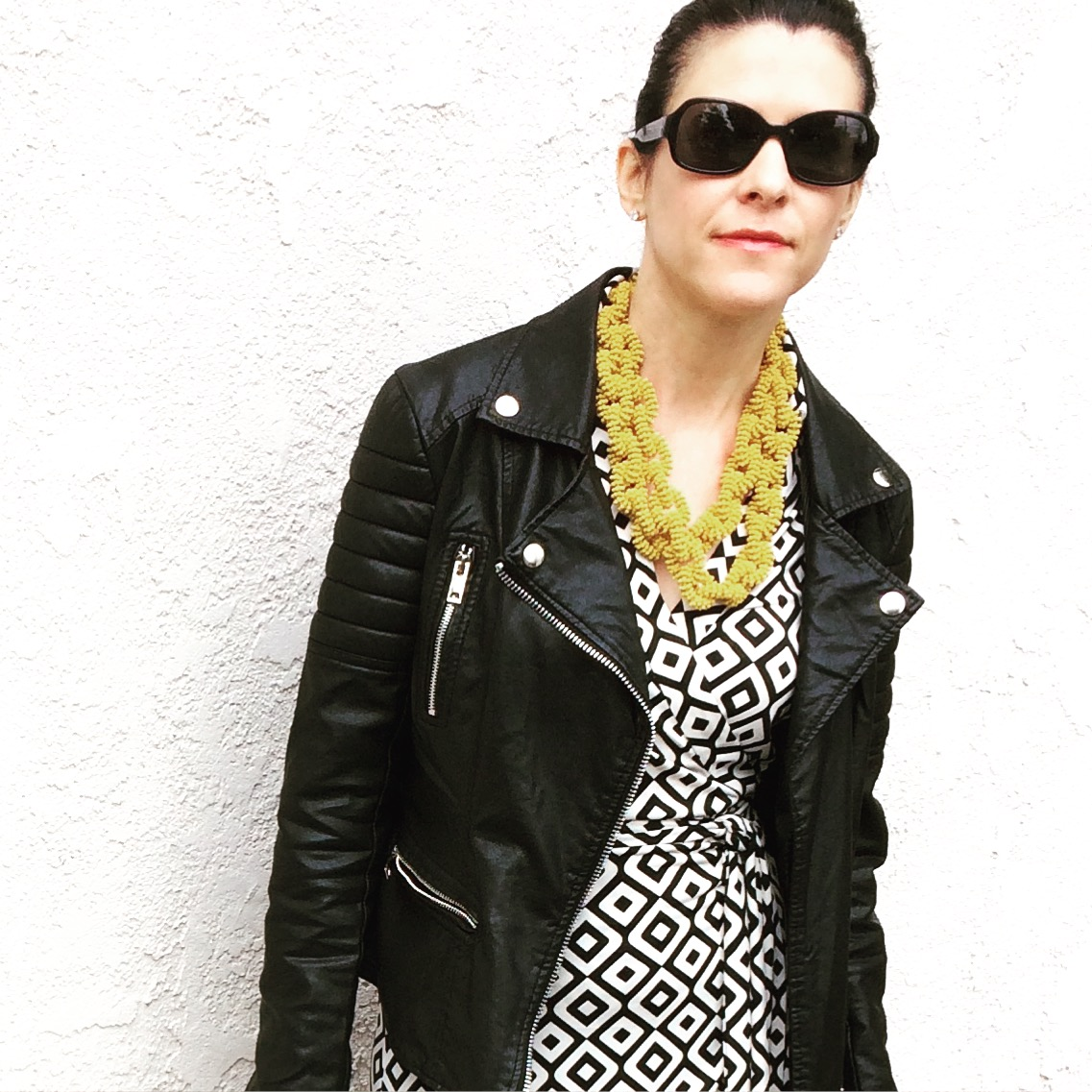 with a moto jacket and wrap dress