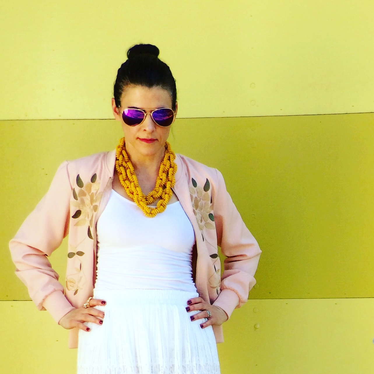 with a pink bomber jacket