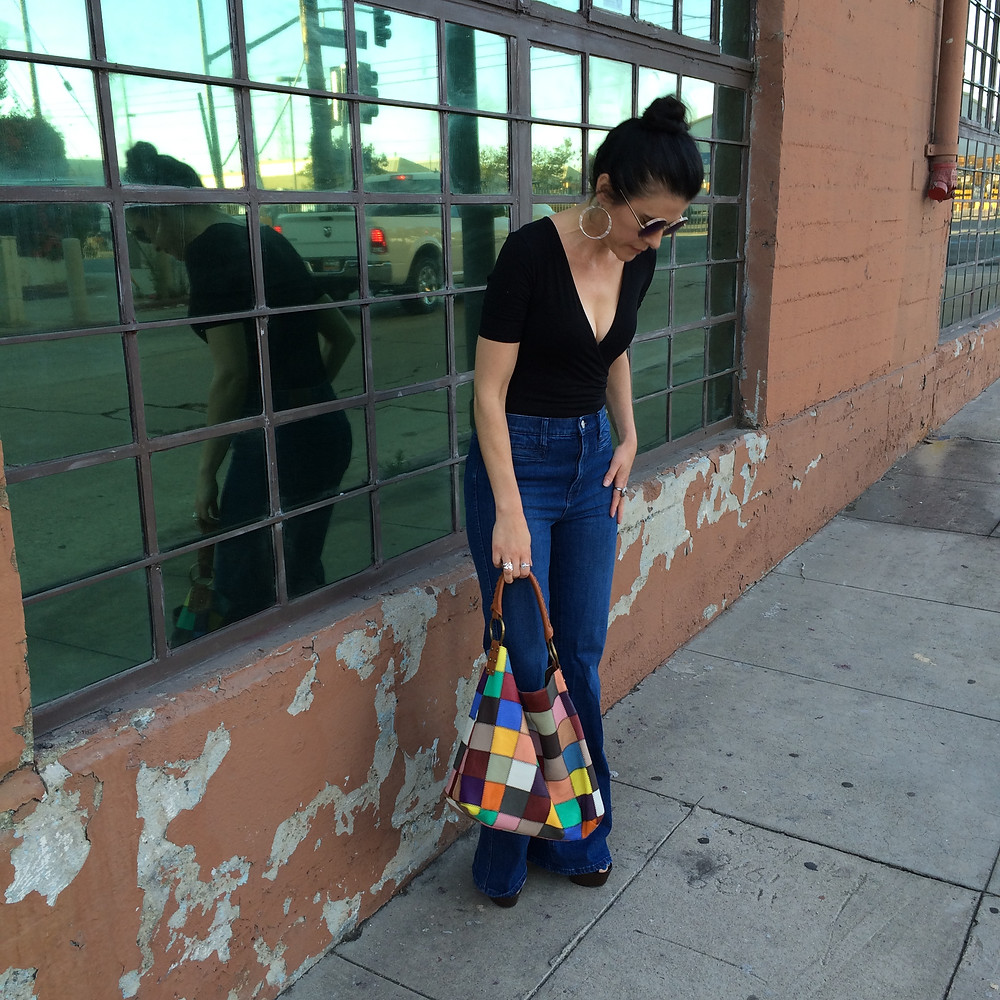 Bodysuit, flare jeans and a patchwork hobo.