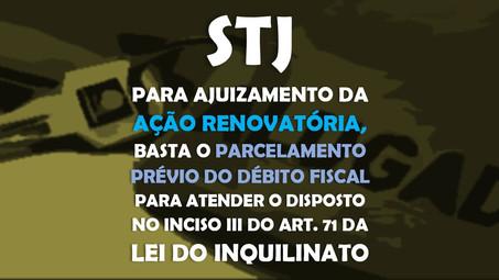 STJ - para o ajuizamento da ação renovatória, basta o parcelamento prévio do débito fiscal para aten