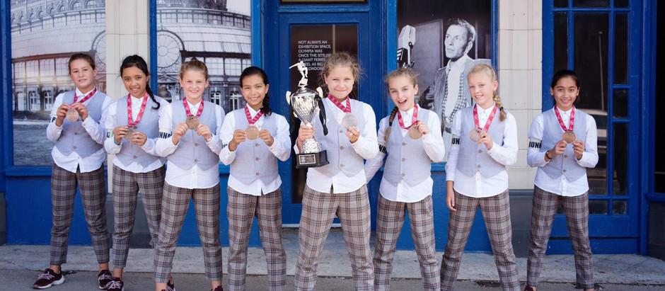 (Krantenartikel) Brons voor de Runnaz kids op het World Street Dance Championships