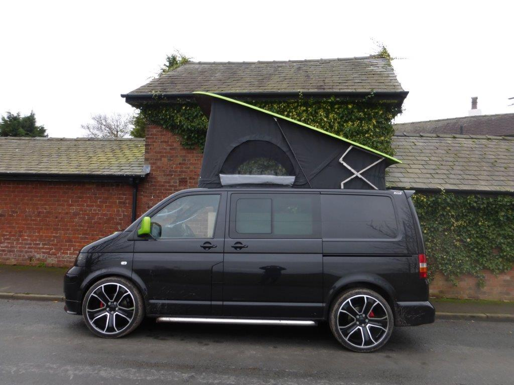 Jenners-van-side-profile-roof-up-windows-unzipped