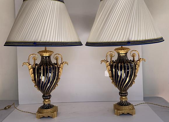 Une paire de lampes en porcelaine de sevres .