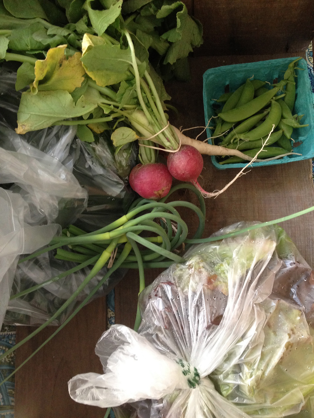 Scapes, radish, snap peas, lettuce - Peachtree Circle Farm