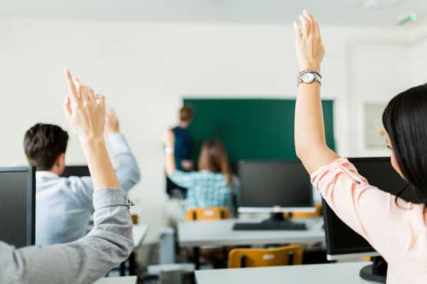 students-raising-hands-during-lesson