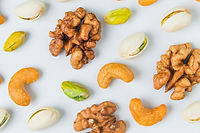 close-up-walnuts-with-pistachios_1205-76