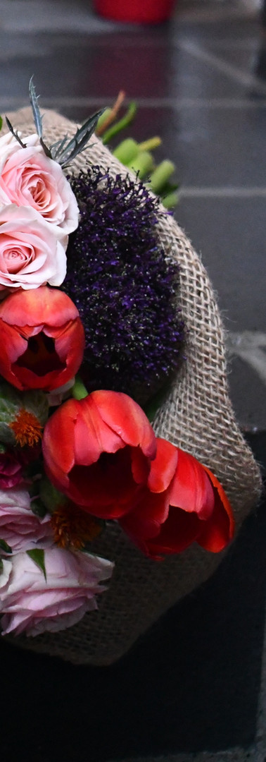 Deep rich gorgeous colors make this hand held bouquet an amazing gift