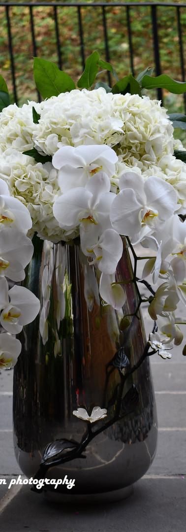 Grand arrangement orchids, hydrengea in a Michael Aram vase...breathtaking!