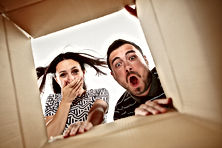 The surprised man and woman unpacking, o