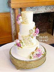 4 tier wedding cake gold leaf