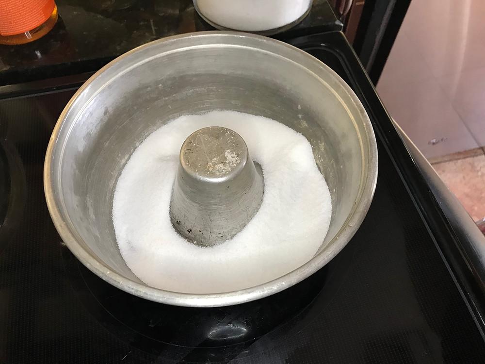 White sugar in a tube cake pan