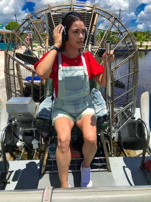 Girl driving an airboat in the Florida Everglades