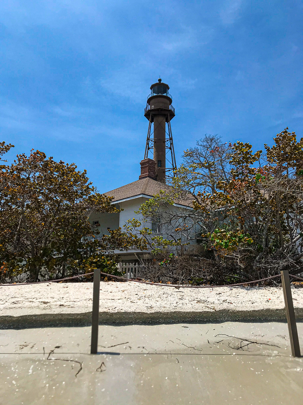 View of lighthouse from the beach at Sanibel Lighthouse beach park