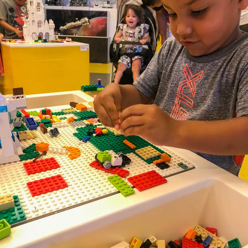 Playing with legos at Lego store at Disn