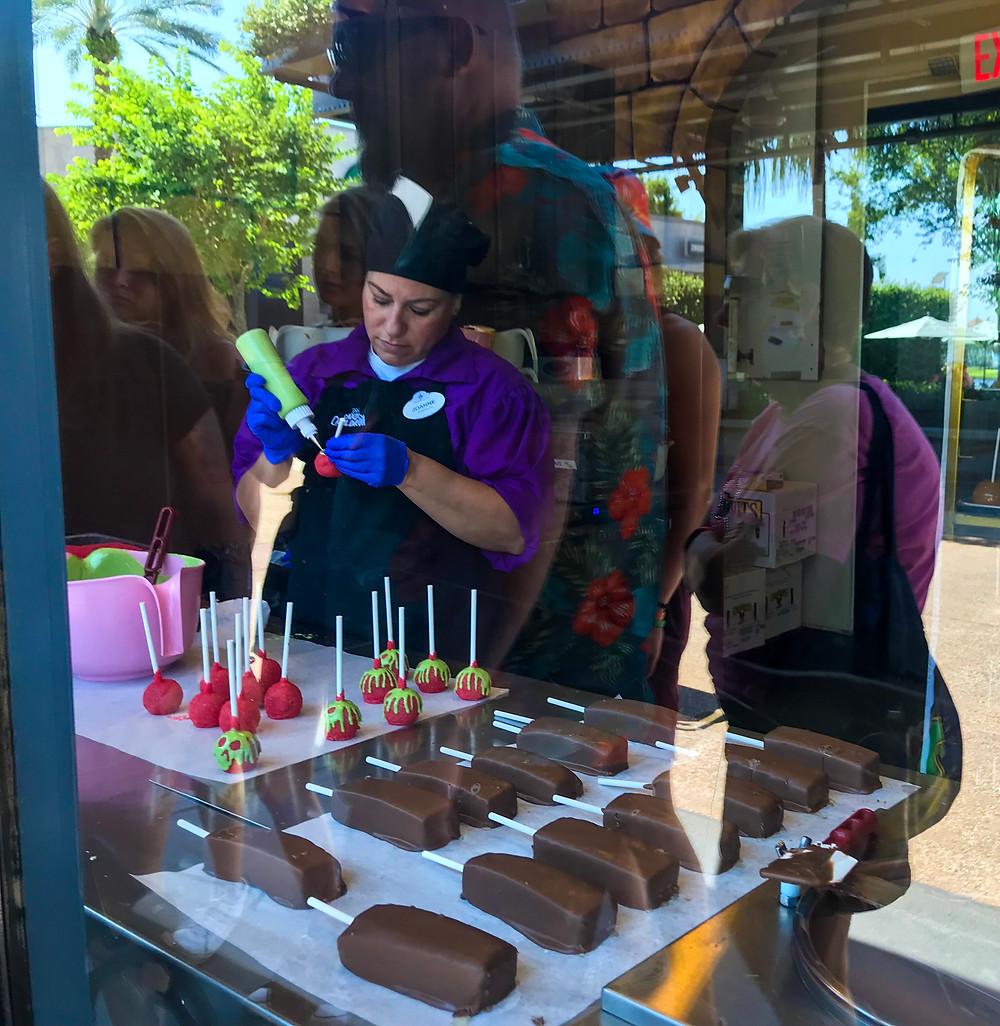 Bonbon maestros at work at Disney's candy cauldron at Disney Springs