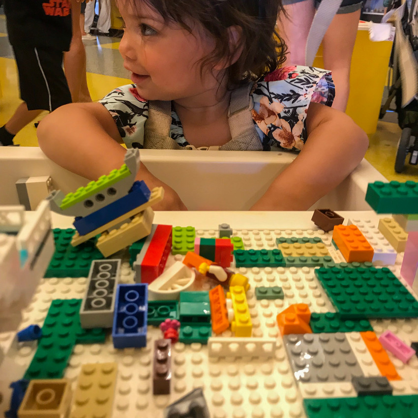 Playing with legos at the Lego store at