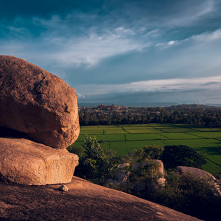 The strange rock formations of Hampi, Karnataka and the paddy fields.