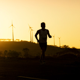 A runner in his stride in Nagar Rising Marathon, as the Sun rises over the city.